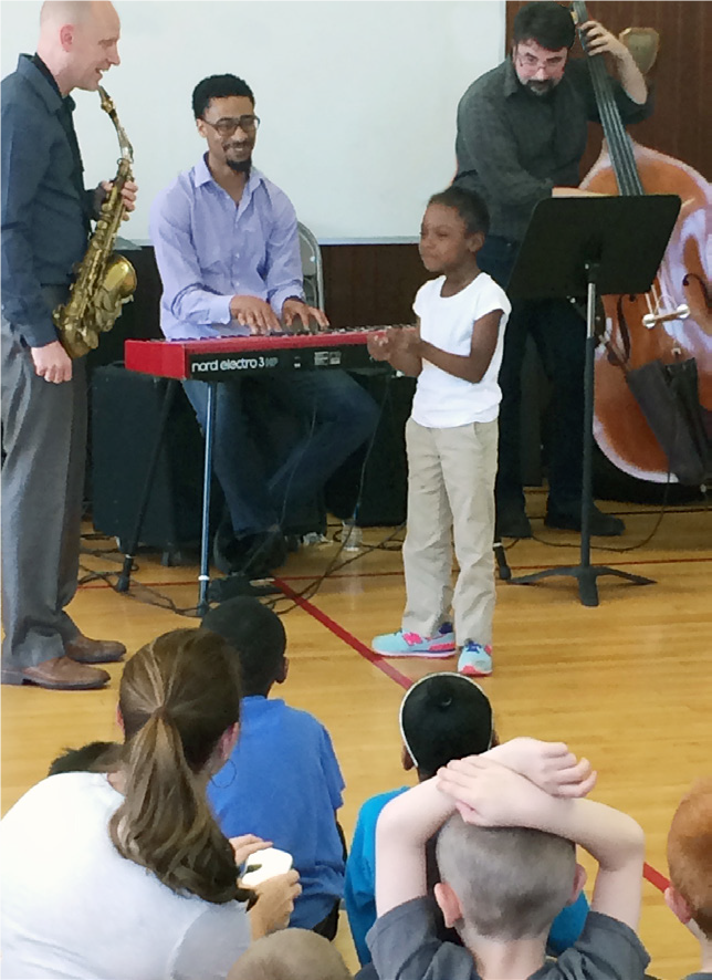 Garfield kid performing with jazz trio