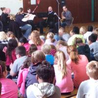 Children listening to classical ensemble